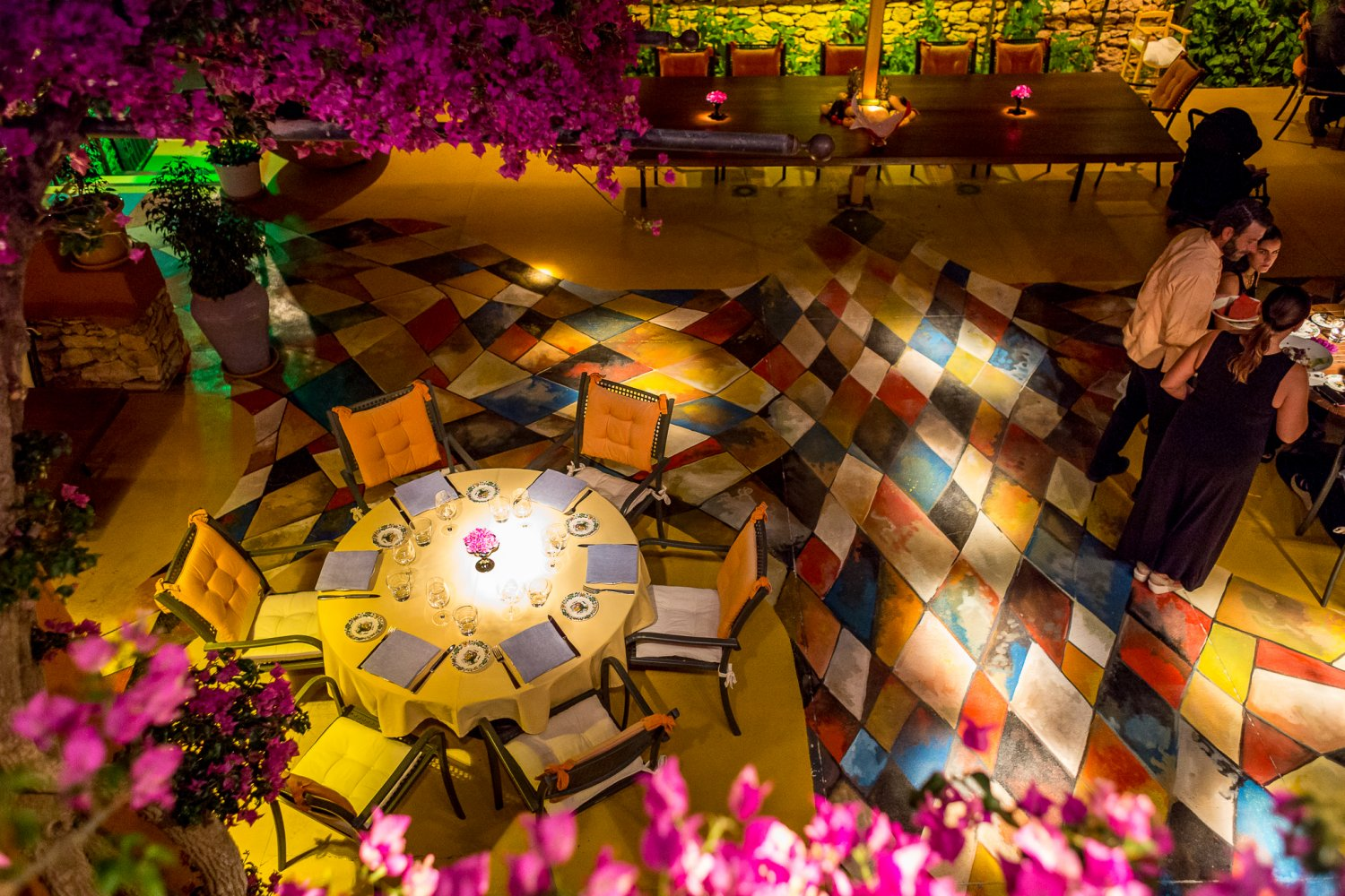 The lush garden with its colourful harlequin mosaic floor