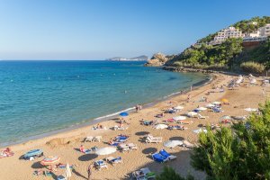 The soft golden sands of Es Figueral beach