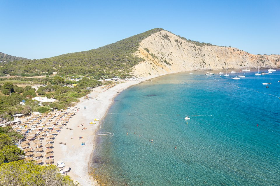 San José, Ibiza. Beautiful And Fashionable Beach Surrounded By Pines And  Jagged Cliffs, Very Popular With Boat Owners.