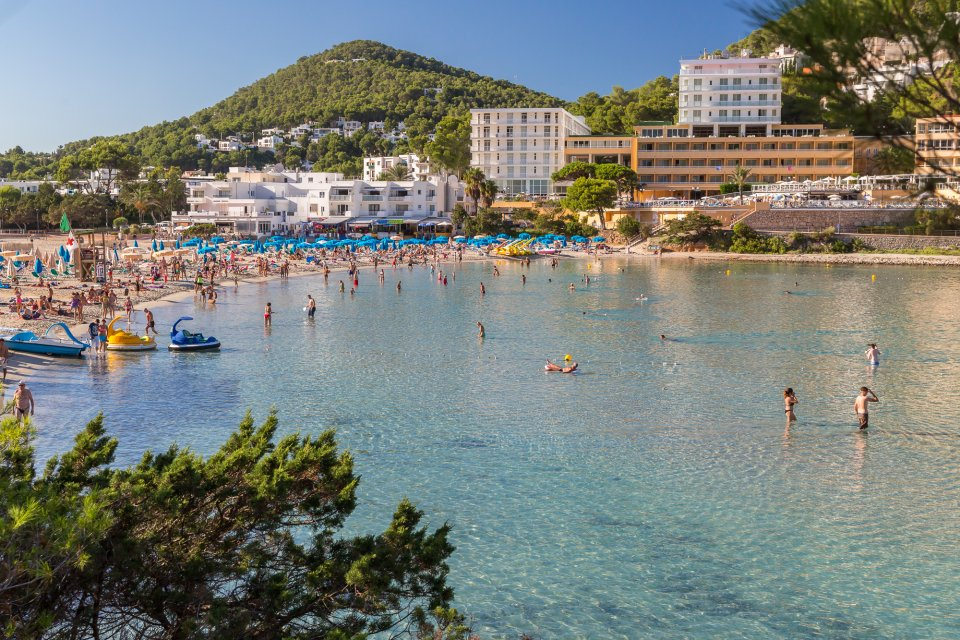 Cala Llonga Is A Complete Mini Resort With A Magnificent Wide Sandy Beach Borders The Immensely Picturesque Bay With Pineclad Hills On Either Side